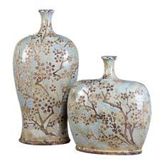 In a set of two, Uttermost's Citrita is made of distressed, crackled sea foam blue ceramic with antique khaki undertones. Designed by Billy Moon. uttermost.com