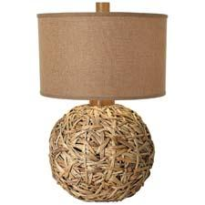 Featured in a natural woven seagrass base, the Seagrass Meadow table lamp stands 28 inches tall. pacificcoastlighting.com