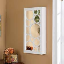 SEI (Southern Enterprises Inc.) will introduce an array of wall mount jewelry armoires inspired by trends in the mirror industry and featuring graphic cut wood overlaying the mirrors. seidal.com