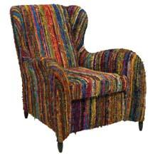 The Adalina Recycled Silk Arm Chair is made of dyed fabric remnants torn into strips, then hand knotted to create the fibers. Each strip is woven by hand. imaxcorp.com