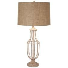 The Hampton design, an addition to Pacific Coast Lighting's Kathy Ireland Home collection, is a metal cage table lamp in a taupe finish and burlap round shade. pacificcoastlighting.com
