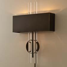 The Radio City sconce, here in bronze, is also available in nickel, as well as a hard wired or portable item. It holds two 40 watt candelabra bulbs and hangs on two keyholes. globalviews.com