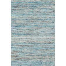 The new Oliver Collection from Loloi is a jacquard-woven dhurrie line that features effervescent polyester silk in a series of colorscapes. loloirugs.com