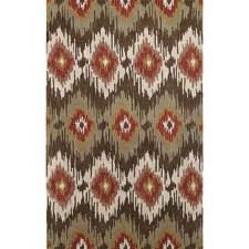 The power of ikat wows in Pow Wow from Capel in three colorways: persimmon, indigo and, here, olive. It is handtufted of 100% wool in India. capelrugs.com