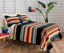 The colorful Suwanee Stripe blanket is a tribute to the patchwork artistry of Seminole Native American women. penwool.com