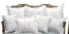The new Boudoir pillows are made from pure cotton percale by Zulu women in South Africa. jacarandaliving.com