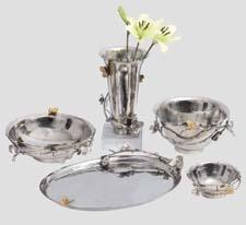 Butterflies and blooms decorate these serving trays and bowls from Mudita Mull. muditamull.com