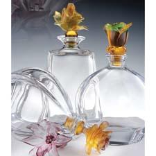 Cristal de Paris offers new flower-topped carafes in a range of colors. cristaldeparis.fr