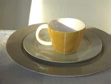 Kri Kri Studio introduces VIT, handmade porcelain dinnerware and accessories in solid colors with white line details. krikristudio.com