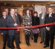 Orian Rugs cut the ribbon on its new showroom at AmericasMart. Orian and AmericasMart executives, including Orian's Brandon Culpepper, with the scissors, and, far right, Kevin Malkiewicz, AmericasMart, celebrated the opening during market.