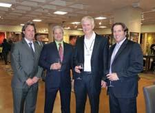 Here in Sphinx by Oriental Weavers' new AmericasMart showroom is, from left, Oriental Weavers' Andy Brumlow and Mike Riley, David Mink of Macy's and Brett Finkelstein, Oriental Weavers, during the debut party.