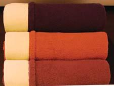 My Favorite Blanket, shown here in three colorways, is made of fleece reversing to sherpa, providing a soft, luxurious and supple feel. wphome.com
