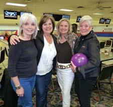 Sharon Davis, ART; Colleen Visage, Swarovski Lighting; Susan Andrulis, Imax Worldwide Imports; and Kathy Bovey, AmericasMart, hang out at the lanes.