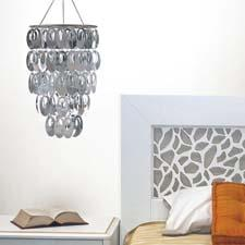 WallPops from Brewster Home Fashions entered the chandelier category, adding a sense of sparkle through mirror embellishments. wall-pops.com