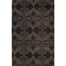 Capel's Lovely collection connects the dots in an elegant and graceful way. The Indo-Tibetan hand knotted group encompasses three whimsical patterns: Fleur, Whimsy and here, Grace. capelrugs.com