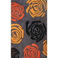 Dynamic's new Symphony collection is handtufted and handcarved of polyester in China, and features today's colors and designs. dynamicrugs.com