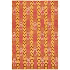 Interior designer David Easton debuts his Indian Sojourn collection of eight ikat designs with Safavieh at market, including this Goya Stripe pattern in pink amber. safavieh.com