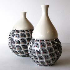 Hand-thrown pottery decorated with raised pigmented clay is new from artist Cynthia Vardhan. cynthiavardhan.com