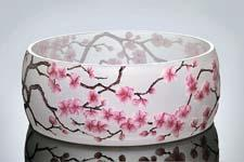 Artel presents the Sakura collection, a sand-blasted, acid-etched design reminiscent of Japanese cherry blossoms. artelglass.com