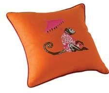 Umbrella Monkey joins Matouk's decorative-pillows lineup. matouk.com