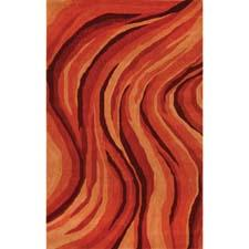 Liora Manné's Inca Lava Sunrise, also available in charcoal, adds a hot touch to the floor in this handtufted wool design. lioramanne.com