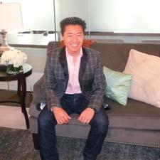 Interior designer Vern Yip has launched his home collection with HSN, including furniture, bedding, window treatments, rugs, lighting and other decor items. Here, he is seated on one of the sofas in the line.