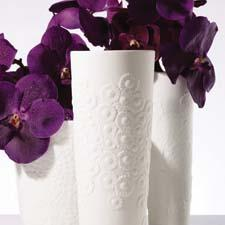 Clusters of peonies, daisies, narcissus and other flowers are featured on a new assortment of porcelain vases and votives presented by Lenox. lenox.com