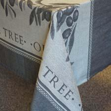 The Olive Tree tablecloth, combining olive branches with a solid-color design, is new from Lintex/Cobra. lintexcobra.com