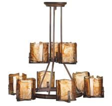 From Murray Feiss' Aris collection, the multi-tier chandelier has a Roman bronze finish and nine amber alabaster glass shade covers. feiss.com