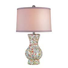 The 6320 Boveney table lamp from Currey & Co. is made of multi-color porcelain mosaic with an off-white linen/pink liner. curreycodealers.com