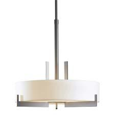 Hubbardton Forge's Axis pendant creates an architectural statement as solid steel arms cradle the luminous cylinder. vtforge.com