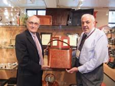 George Lappas of Lappas Silversmiths and Richard Cohen of Richard Cohen Inc. highlight a showroom product at 7 W.
