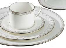 Swags of raised dots, like icing on a grand wedding cake, decorate Iced Pirouette, a new platinum-banded bone china dinnerware pattern from Lenox. lenox.com