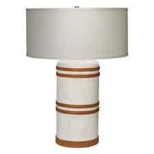 Jamie Young's canvas introductions include this large canvas barrel table lamp, which has tan leather strapping details. jamieyoung.com