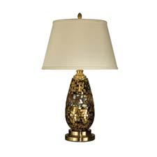 This antique gold with pebble stone table lamp from Dale Tiffany is from its mosaic art glass collection. daletiffany.com