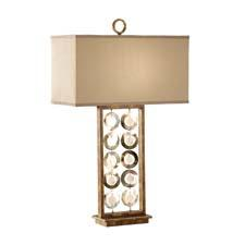 From Murray Feiss' Lyric collection, this table lamp has a painted bronze finish and natural shell medallions, with a faux silk gold shade. feiss.com