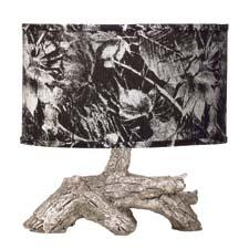 The miniature tree-like Dubois lamp from Kichler has a base finished in distressed silver and is topped with a metallic silver leaf patterned shade. kichler.com