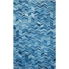 The Vintage Blue Jeans area rug from Tozai is made of cotton and can also be used as a wall tapestry. tozaihome.com