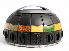 The KitchenArt Spice Dome features a patented Auto-Measure Dial that dispenses 1/4 teaspoon of spice with each click. It includes 16 removable canisters on a rotating base. foxrunbrands.com
