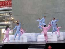 A troupe of pajama-clad dancers performed on mattresses throughout the first day of market.