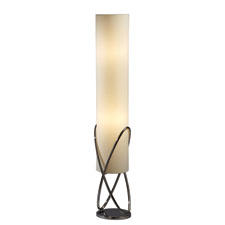 With its crisscrossed painted chrome elements in an elongated white shade, the Internal floor lamp from Nova has a dimmer switch. novalamps.com