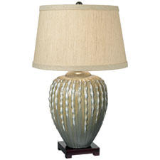 Offered in taupe, here, or beige, the Cactus Reflections table lamp from Pacific Coast Lighting is ceramic and has an off-white linen shade. pacificcoastlighting.com