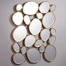 The ETE501 Free Form mirror from Tozai is both a mirror as well as a fun, decorative wall element. tozaihome.com