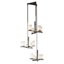 Suited for large entry ways, Hubbardton Forge's Ondrian Triple balances asymmetry, hand hammered steel, and simple clean lines. hubbardtonforge.com