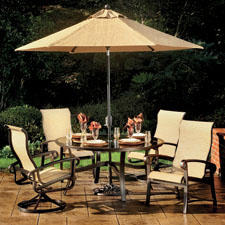 Agio's Arrington comes complete with four chairs, 60-inch round table and umbrella. agiousa.com
