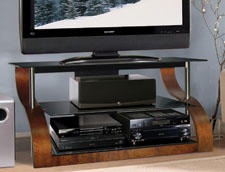 This audio/video furniture features sloping sides crafted of bent wood in a vibrant espresso finish. It accommodates most flat-panel TVs up to 55 inches, plus at least four a/v components on tinted glass shelves. This model features a Cable Management System to hide and manage unsightly cables and power chords. bello.com