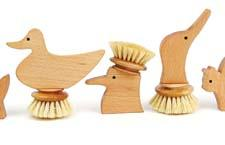 Arbiter's collection of Italian-made whimsical wooden dish brushes in animal and natural forms make scrubbing fun. arbitercollection.com
