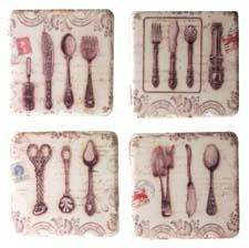 New polyresin coasters from Manual Woodworkers & Weavers feature a French theme displaying ornate silverware of the 19th century along with postmarked stamps, calligraphy and scrollwork. manualww.com