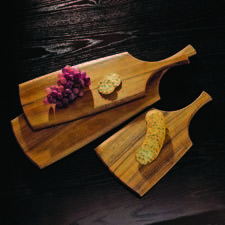 Dansk showcases its Classic Fjord Paddle Servers in three sizes. dansk.com