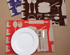 The Chef collection from Two's Company includes this grouping of kitchen towels, placemats and napkins. twoscompany.com